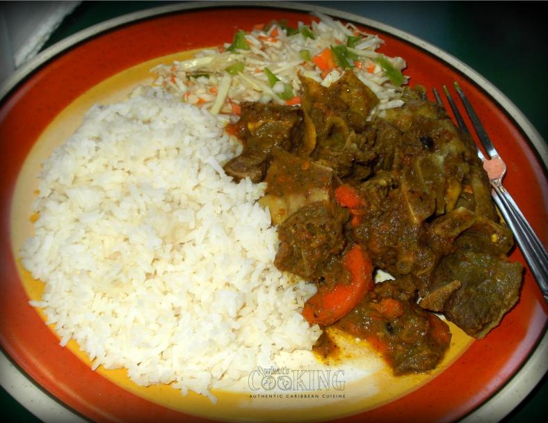 curry goat with rice and cabbage slaw