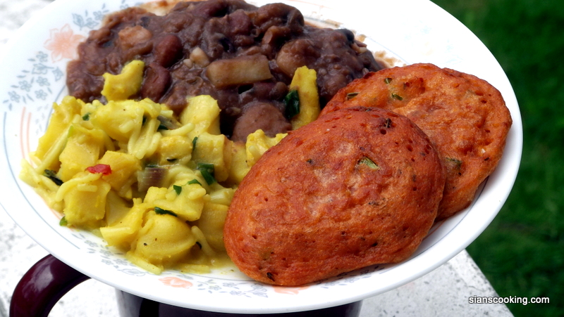 Tomatoes n herbs fritters w/ curry conch and stewed lentils